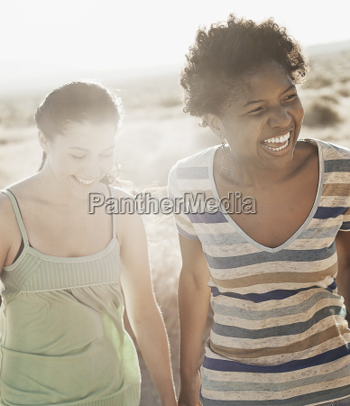 two women outdoors in open country