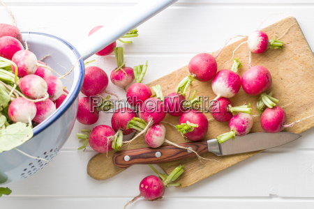 fresh radishes on old cutting board
