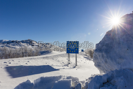 backlit scene with sign in finnish