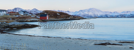 fishing hut and high mountains in