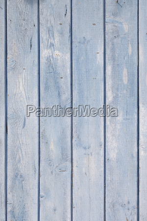 close up of blue painted wooden