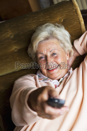 senior woman using remote