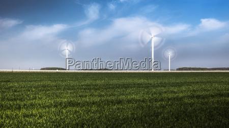 wind turbines in field germany