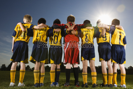 a team of soccer players standing