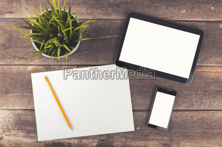 workspace with digital tablet phone and
