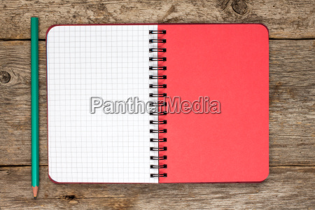 blank spiral notebook with pencil