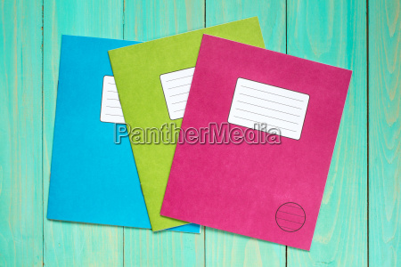 exercise books on the blue wooden