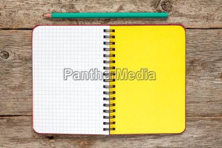 spiral notebook and penciltop view