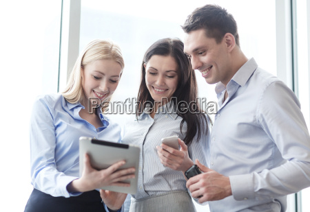 business team working with tablet pcs