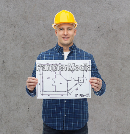smiling male builder in helmet with