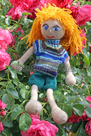 embedded handmade dolls on pink roses