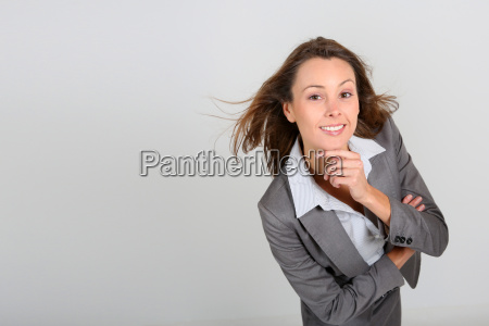 successful business girl leaning towards camera