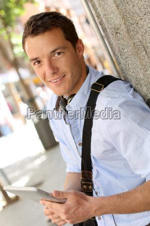 casual man in town using digital