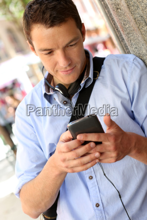 man checking mails on smartphone in