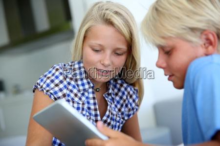 teens websurfing on internet with digital