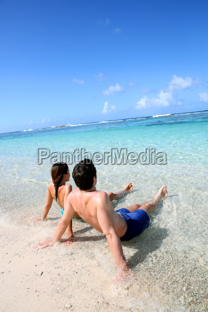 couple relaxing in carribean sea water