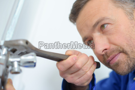 plumber hard at work on a