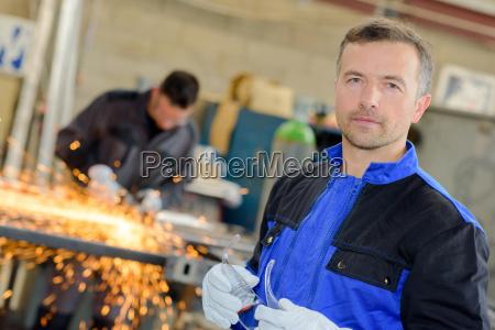 man in the welding shop