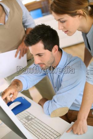 workteam in office working on desktop