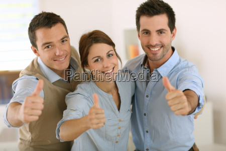 portrait of cheerful business team showing