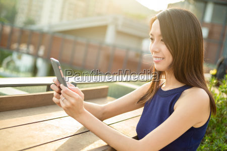 asian woman use of cellphone at