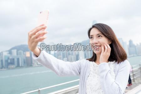 woman taking selfie in hong kong