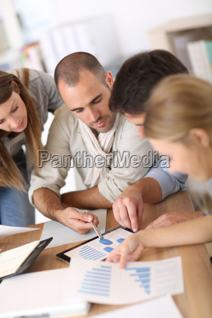 business team working on marketing plan