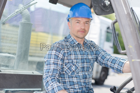 portarit of man driving forklift