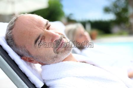 senior man in spa hotel relaxing