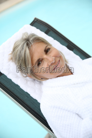 senior woman in spa hotel relaxing