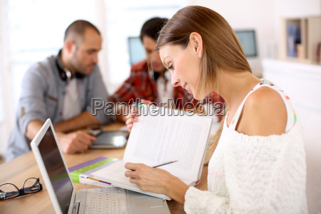 girl in class studying with laptop