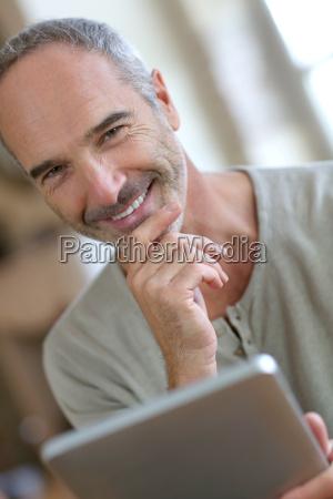 50 year old man using digital