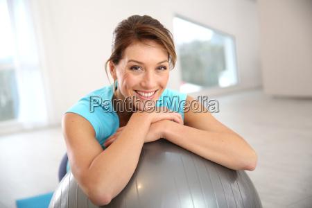 woman doing pilates and balance exercises