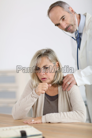 senior woman being examined by doctor