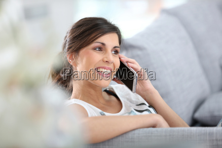 young cheerful woman in couch talking