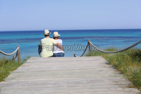 back view of couple relaxing on