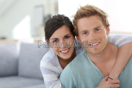 smiling young couple relaxing in sofa