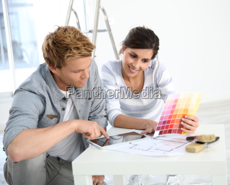 couple in new home choosing wall
