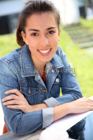 portrait of student girl sitting outside
