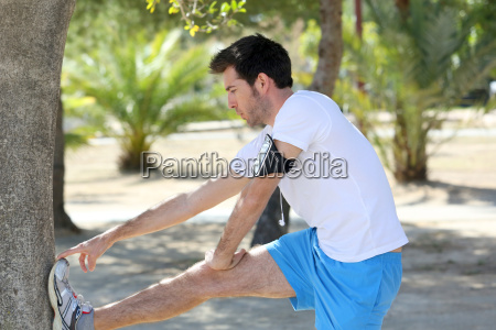 man stretching out after running session