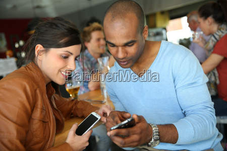 young people in coffee shop using