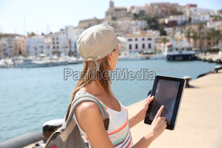 cheerful tourist girl using digital tablet