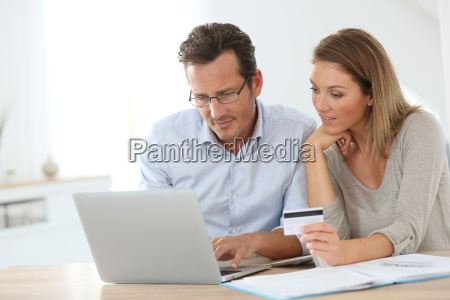 couple shopping on internet with credit