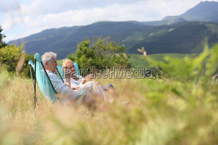 senior couple relaxing in folding chairs