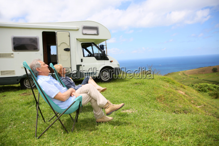 senior couple relaxing in camping folding