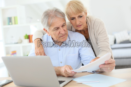 senior couple doing the income tax