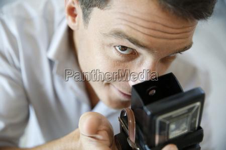 closeup of photographer using vintage camera