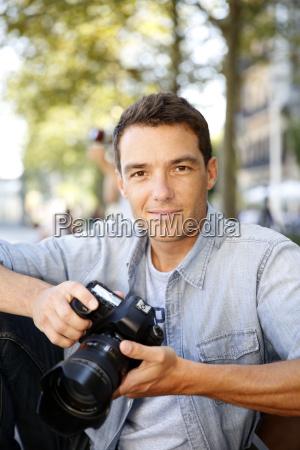 fotograf der bilder in der strasse