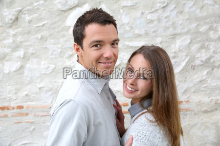 cheerful couple standing in front of
