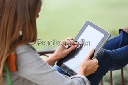 closeup of woman using digital tablet